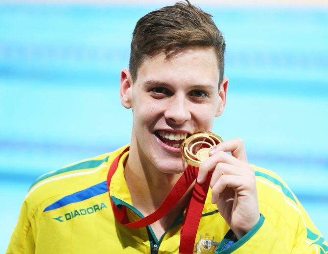 Gold medallist Mitch Larkin of Australia poses after the medal ceremony for the Men's 200m Backstroke Final