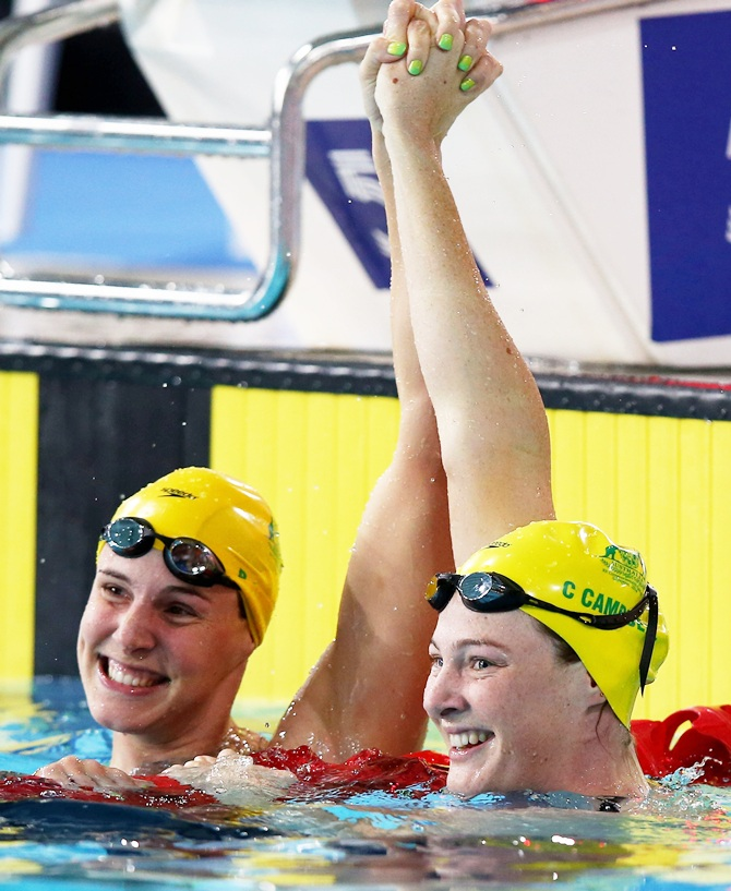 Cate Campbell, right, of Australia celebrates winning the gold medal with silver medallist and her sister Bronte Campbell
