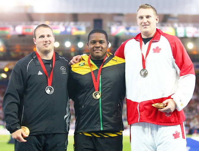 From left, Silver medalist Tom Walsh of New Zealand, gold medalist O'dayne Richards   of Jamaica and bronze medalist Tim Nedow of Canada stand on the podium during the medal ceremony for the Men's shot put
