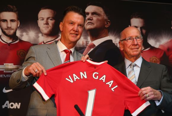 Louis van Gaal appears at a press conference with Sir Bobby Charlton as he is   unveiled as the new Manchester United manager at Old Trafford