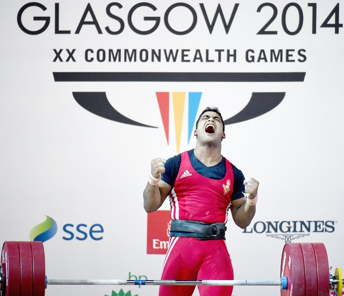 Vikas Thakur of India reacts after winning Silver in the mens 85kg weightlifting at the   Clyde Auditorium during day five of the Glasgow 2014 Commonwealth Games