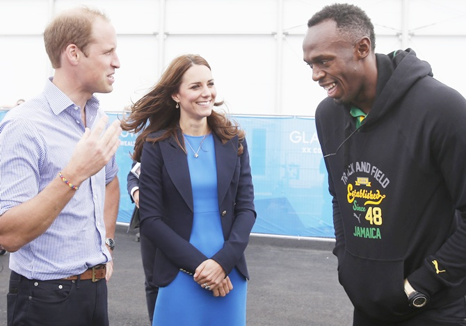 From left, Prince William, Duke of Cambridge and Catherine, Duchess of Cambridge meet Usain Bolt during a visit to the Commonwealth Games Village