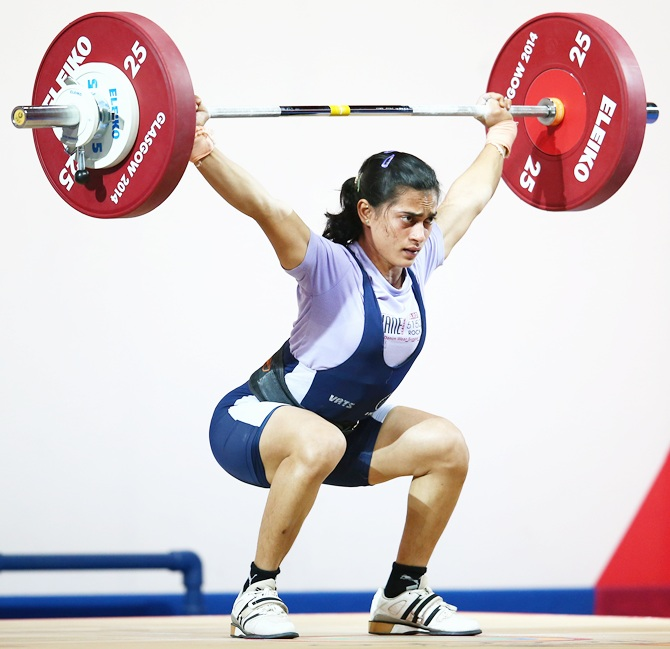 India's Santoshi Matsa lifts in the women's 53kg Group A weightlifting at the Scottish Exhibition and Conference Centre