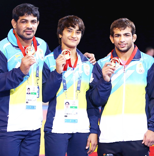 From left, Indian medalists Sushil Kumar (gold 74kg) Vinesh (gold 48kg) Amit Kumar (gold 57kg)