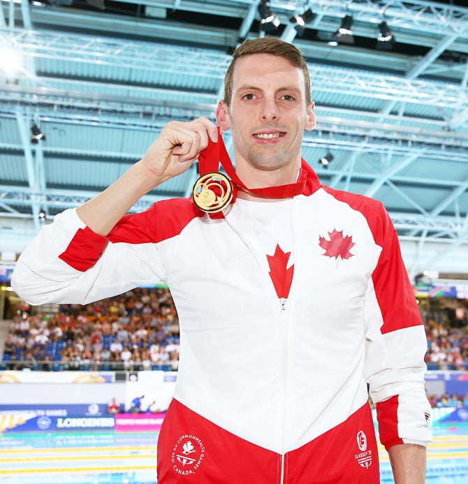 Ryan Cochrane of Canada poses with his gold medal