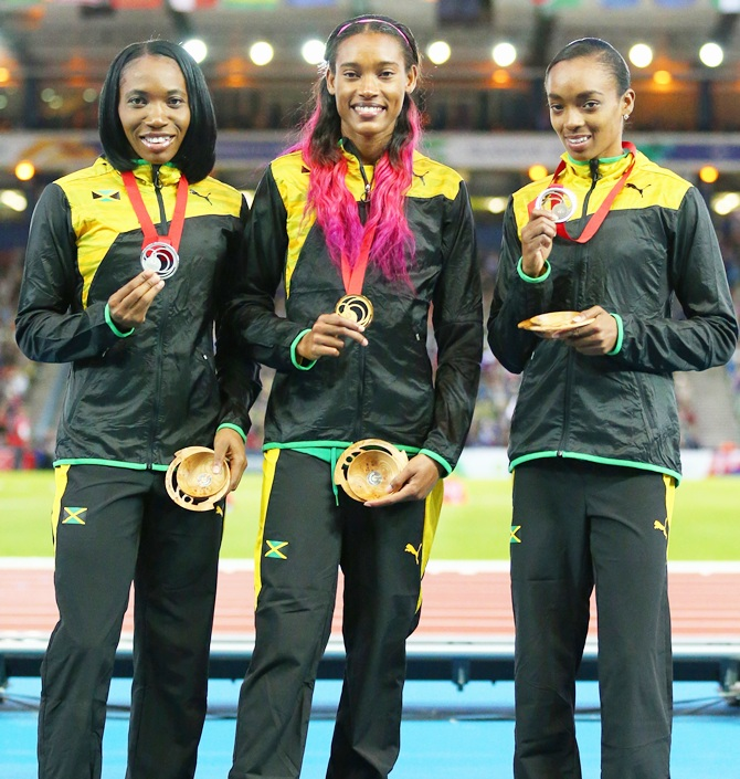 Silver medallist Novlene Williams-Mills, gold medallist Stephanie McPherson and bronze medallist Christine Day on the podium