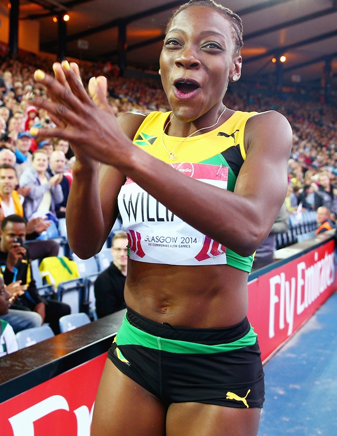 Kimberly Williams of Jamaica celebrates winning gold in the women's Triple Jump final