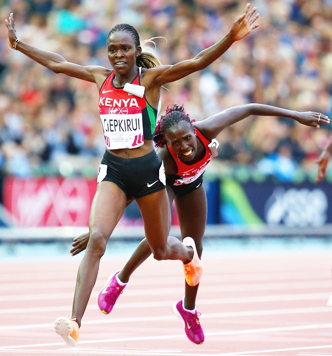 Joyce Chepkirui of Kenya crosses the line to win gold ahead of Florence Kiplagat of Kenya in the women's 10,000 metres final at Hampden Park during day six