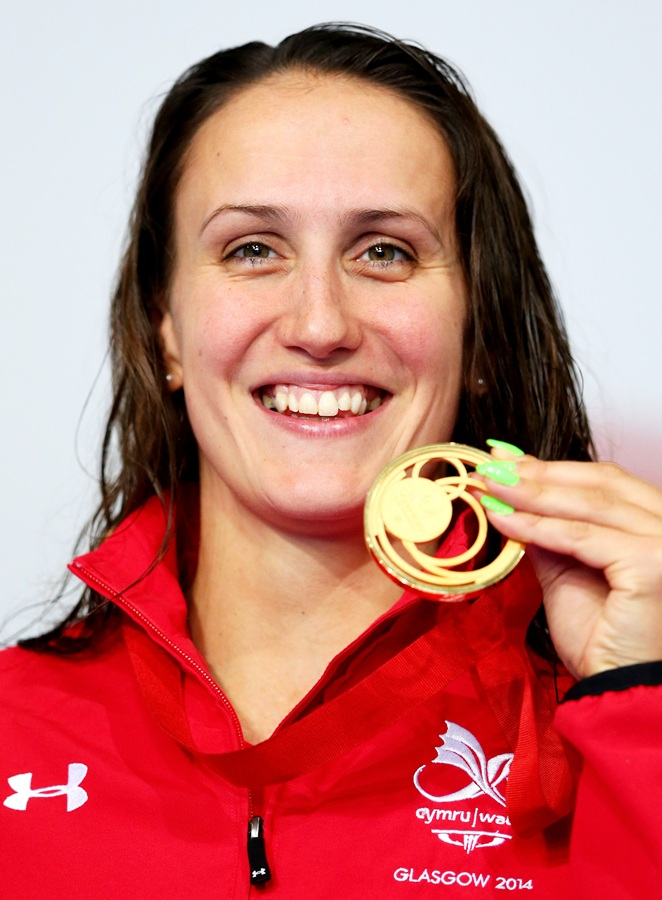 Gold medallist Georgia Davies of Wales poses during the medal ceremony for the women's 50m Backstroke final