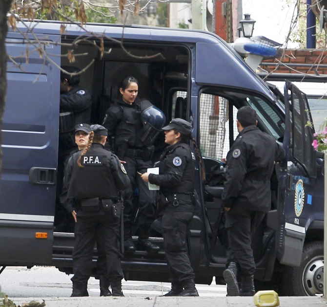 Police stand near the home of Juan Alberto Cabral, father of Juventus' Carlos Tevez, in Buenos Aires
