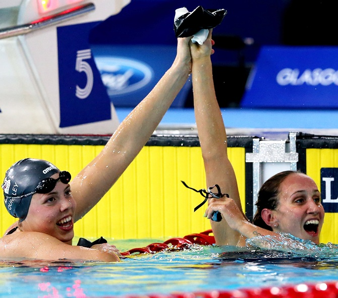 Georgia Davies, right, of Wales celebrates winning the gold medal with silver medallist Lauren Quigley of England