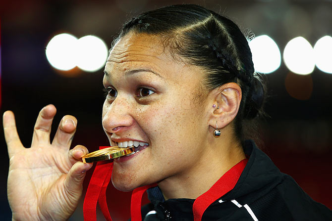 Gold medalist Valerie Adams of New Zealand poses on the podium during the medal ceremony for the Women's Shot Put at Hampden Park during day seven of the Glasgow 2014 Commonwealth Games on Wednesday