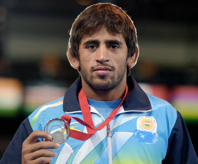 India's Bajrang Kumar on the podium with the silver medal