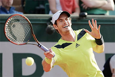Andy Murray plays a return against Philipp Kohlschreiber on Saturday