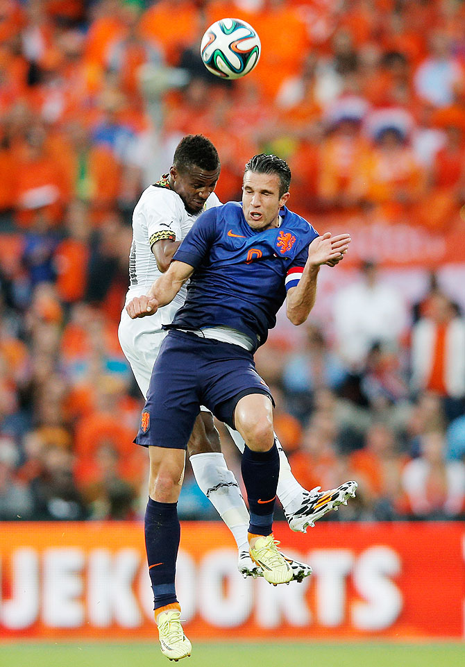 Robin Van Persie of Netherlands and Jerry Akaminko of Ghana battle for the header during the International Friendly match at De Kuip in Rotterdam, Netherlands, on Saturday