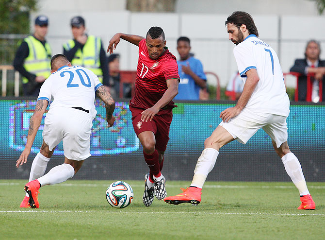 Nani of Portugal battles with Jose Holebas and Giorgos Samaras of Greece during the International Friendly at the National Stadium in Lisbon, Portugal, on Saturday