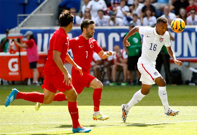 Julian Green (right) of the US gets the ball past Turkey's Gokhan Gonul (left) and Hakan Kadir Balta