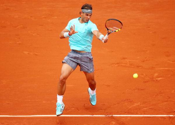 Rafael Nadal of Spain returns a shot in his men's singles match against Dusan Lajovic of Serbia at the French Open.
