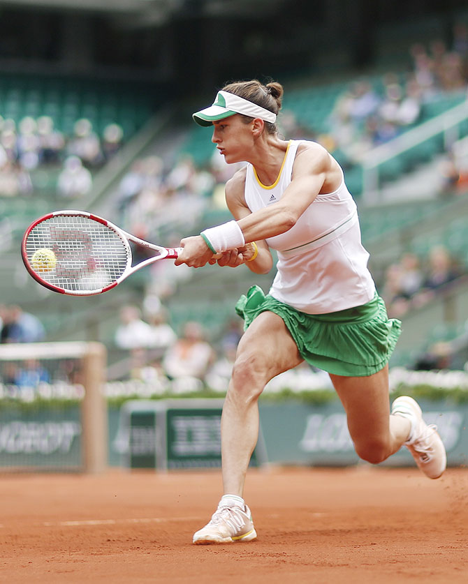 Andrea Petkovic of Germany returns a backhand to Kiki Bertens of the Netherlands.