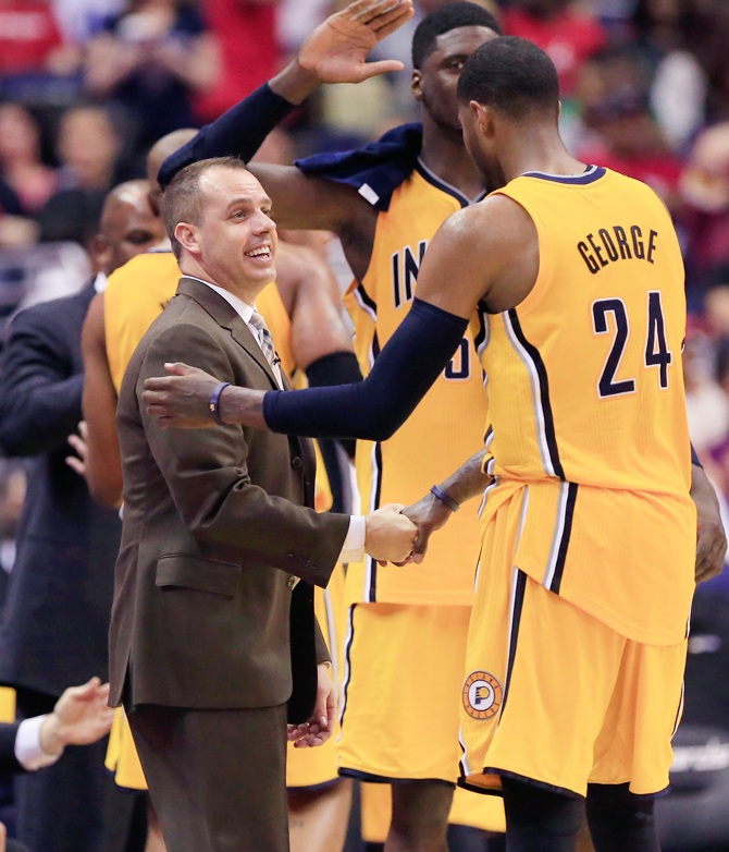 Paul George of the Indiana Pacers shakes hands with head coach Frank Vogel