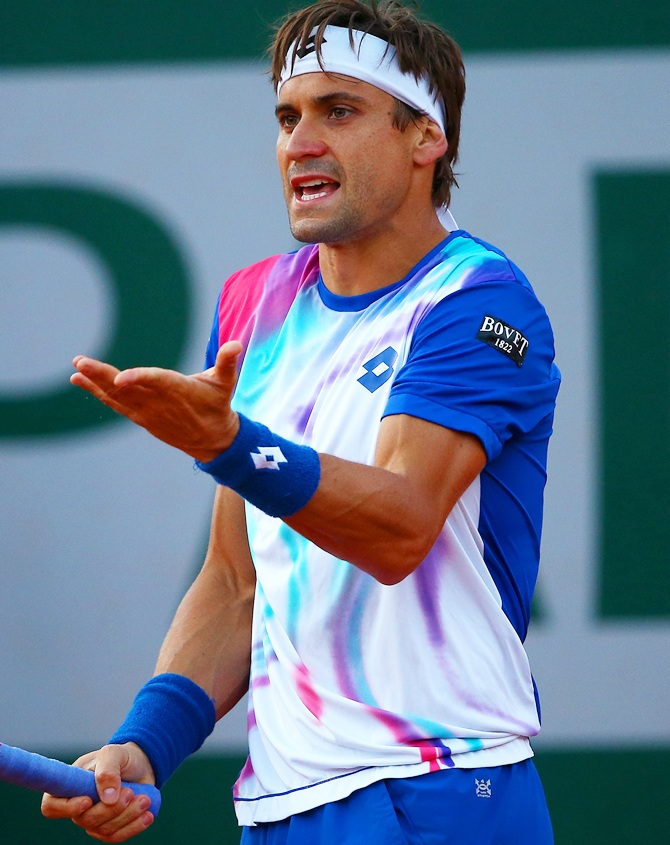 David Ferrer of Spain reacts during his men's singles match against Rafael Nadal of Spain
