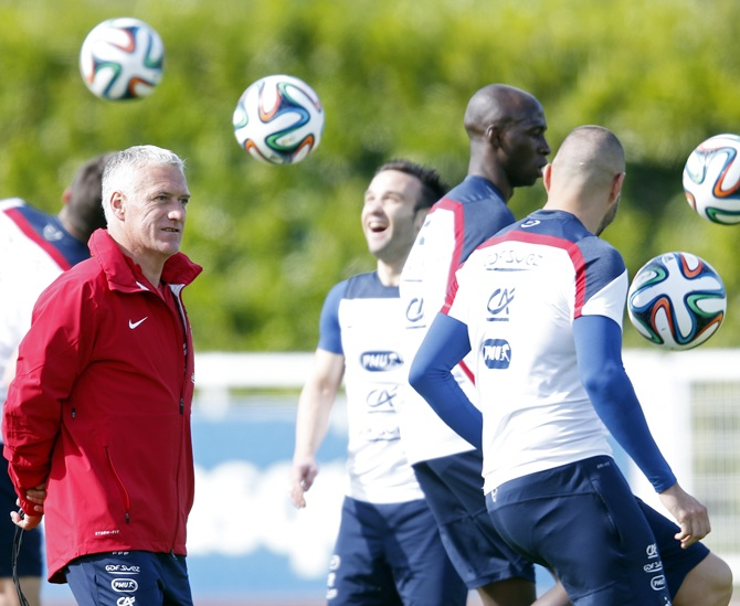 France's national soccer team coach Didier Deschamps,left, conducts a training session
