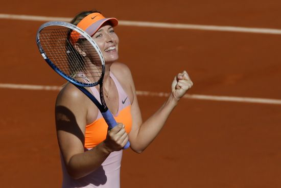 Maria Sharapova of Russia reacts after winning her women's semi-final match against Eugenie Bouchard of Canada