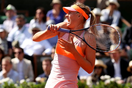 Maria Sharapova hits a return during her semi-final match against Eugenie Bouchard