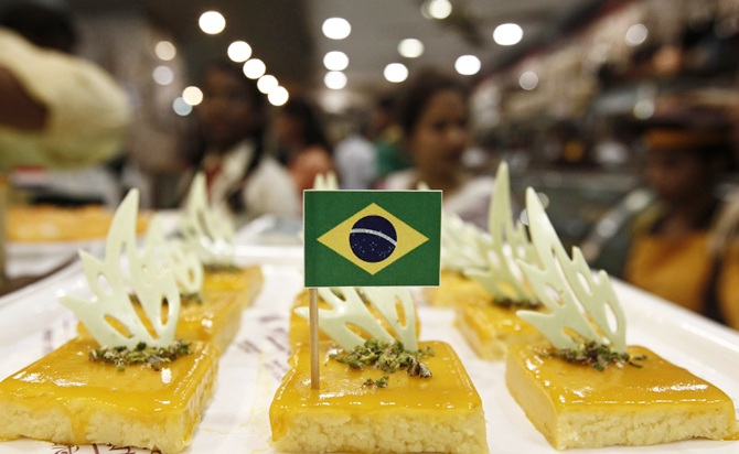 A Brazilian national flag is fixed on a piece of sweet