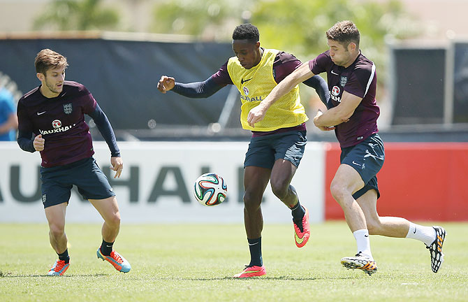 Adam Lallana, Danny Wellbeck and Gary Cahill during an England training session at the Barry University Campus