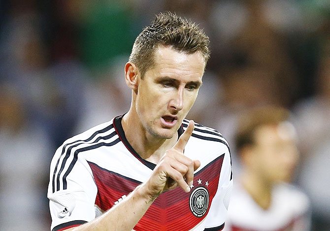 Germany's Miroslav Klose celebrates his goal during their friendly soccer match against Armenia in Mainz on Friday