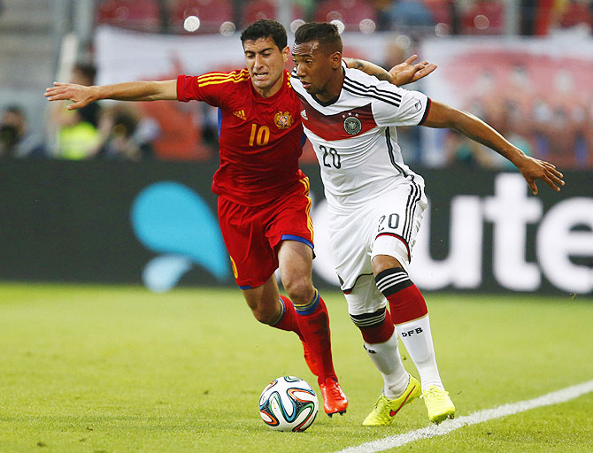 Germany's Jerome Boateng (right) challenges Armenia's Ghazaryan during their international friendly on Friday