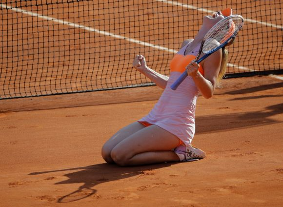 Maria Sharapova of Russia reacts after winning her women's singles final match against Simona Halep of Romania