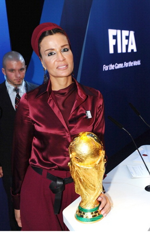 Sheika Moza bint Nasser poses with the World Cup trophy after Qatar were awarded the 2022 FIFA World Cup