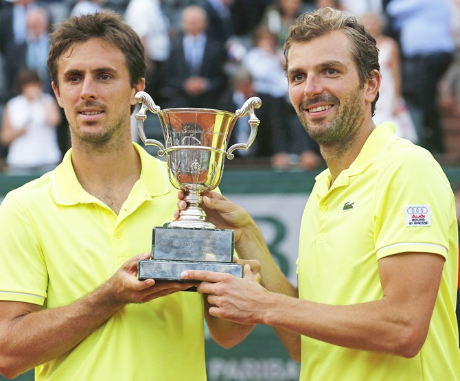 Julien Benneteau,right, and Edouard Roger-Vasselin of France pose with the trophy