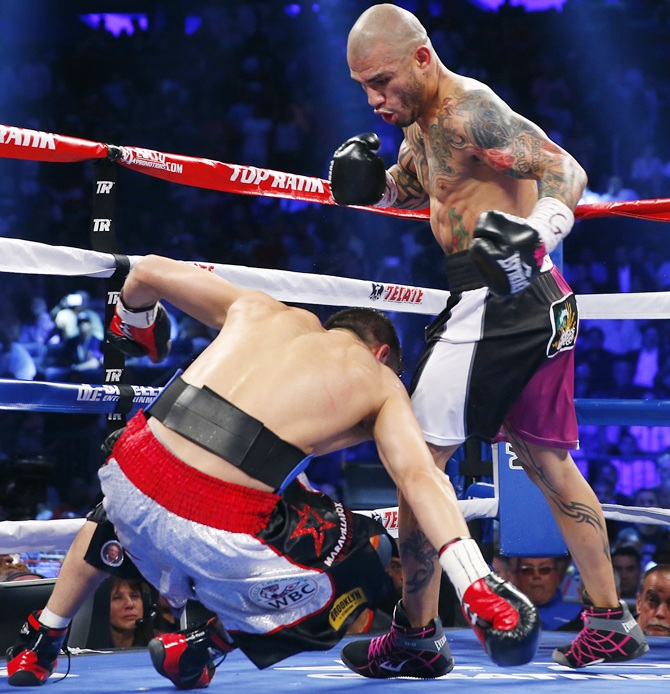 Miguel Cotto of Puerto Rico knocks Sergio Martinez of Argentina