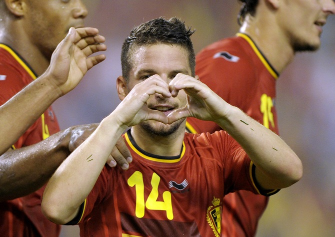 Belgium's Dries Mertens reacts after scoring against Tunisia