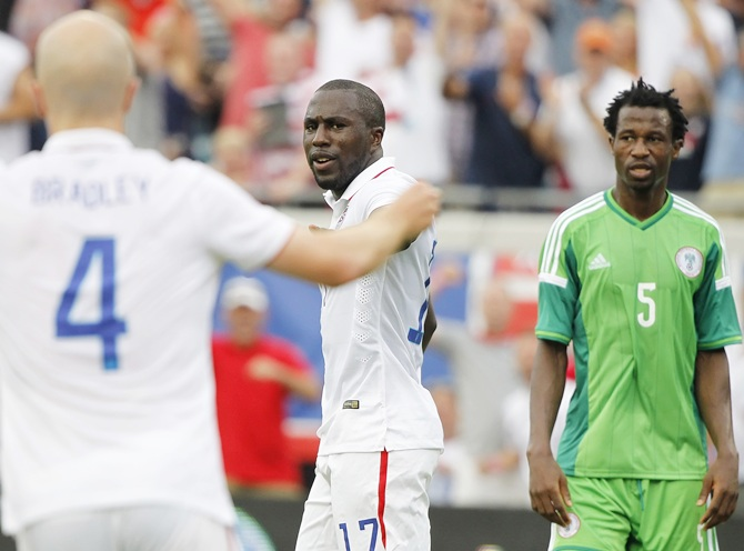 United   States forward Jozy Altidore,centre, reacts after he scored a goal during the second half against the Nigeria