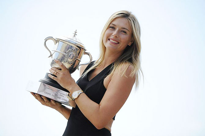 Maria Sharapova poses with her trophy on Sunday