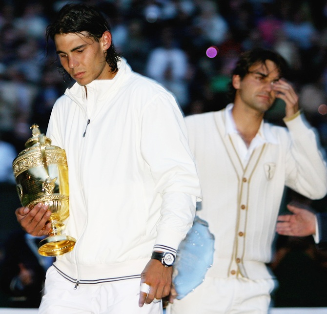 Rafael Nadal of Spain walks off with the trophy after winning the Wimbledon Championship in 2008