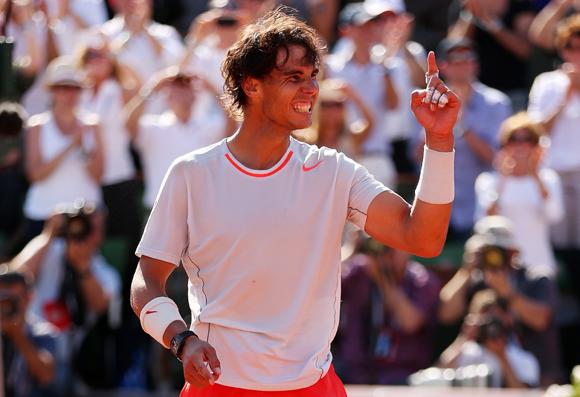 Rafael Nadal of Spain celebrates against David Ferrer in 2013