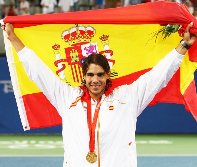 Rafael Nadal of Spain celebrates winning the gold medal against Fernando   Gonzalez of Chile during the men's singles gold medal tennis match held at   the Olympic Green Tennis Center of the Beijing 2008 Olympic Games