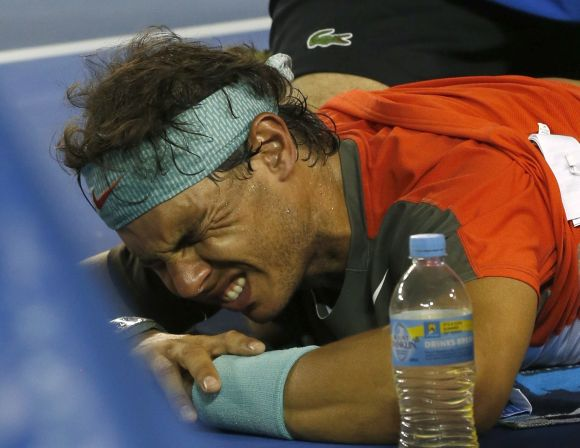 Rafael Nadal of Spain reacts as he receives treatment during the Australian Open's men's singles final in 2014