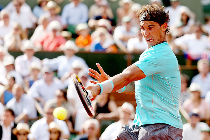 Rafael Nadal of Spain returns a shot during his men's singles final match against Novak Djokovic of Serbia on Sunday