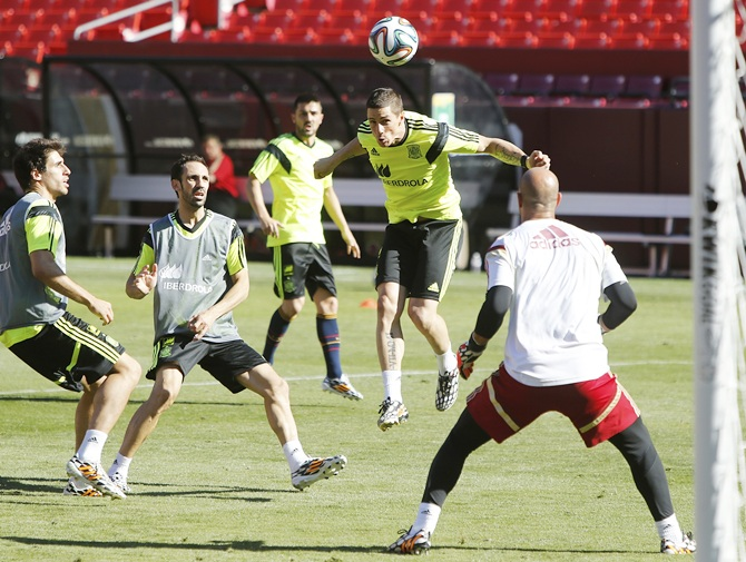Fernando Torres,second right, heads a ball on goal as he participates in Spain's national soccer team training session