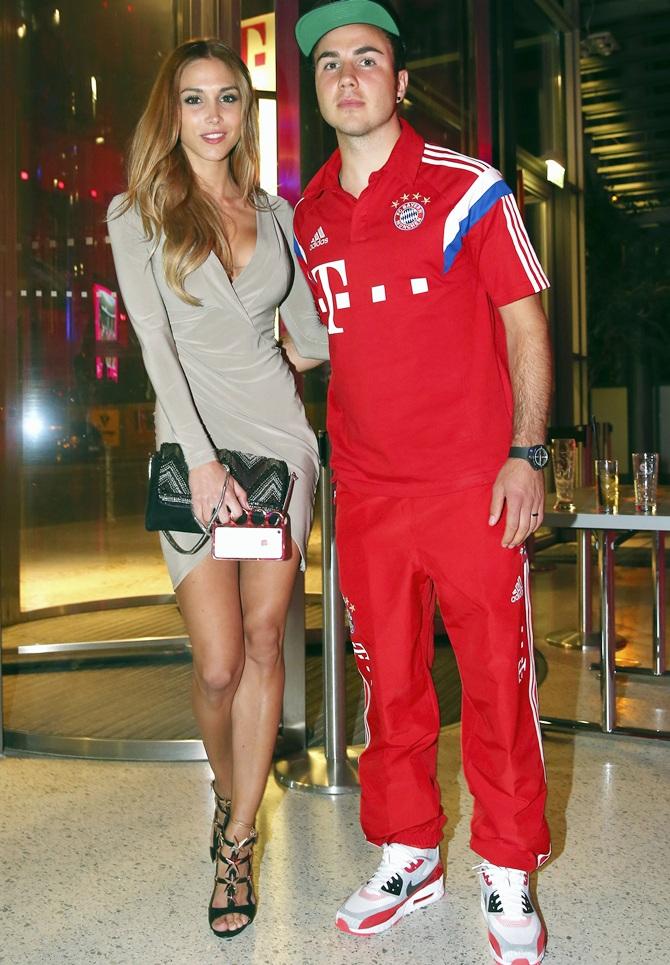 Bayern Munich's Mario Goetze and Ann-Kathrin Brommel