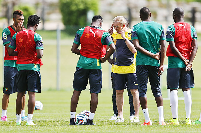 Cameroon's national soccer team coach Volker Finke (centre) talks to players during a training session
