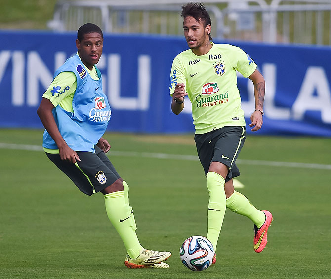 Neymar (right) in action during a training session at the squad's Granja Comary training complex, on June 09, 2014 in Teresopolis, 90 km from downtown Rio de Janeiro, Brazil, on Monday