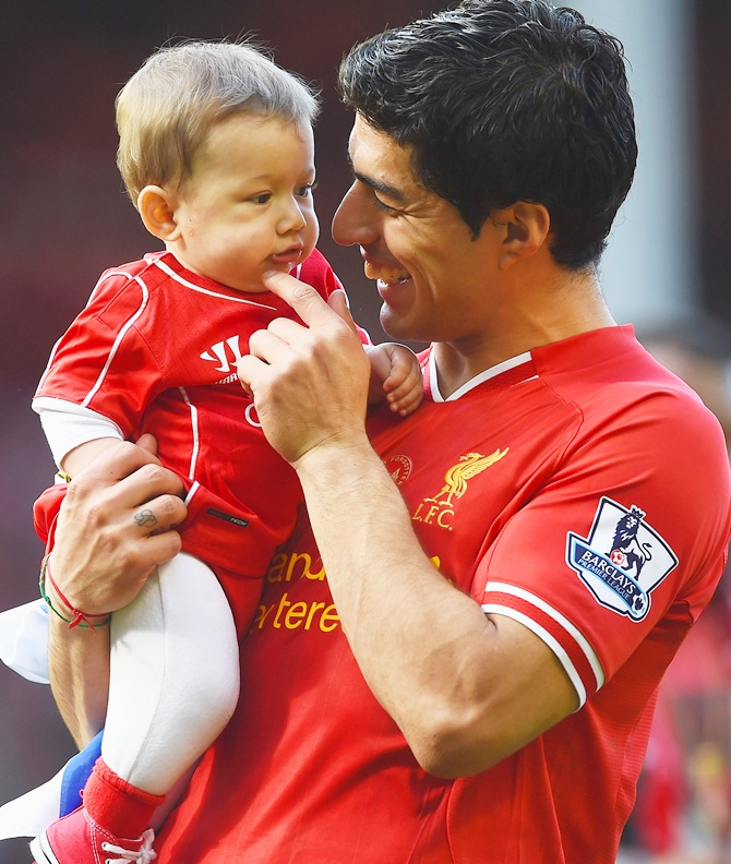 Luis Suarez of Liverpool with his son Benjamin