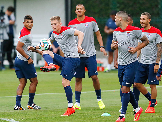 Aron Johannsson of the United States runs drills during their training session at Sao Paulo FC on Monday